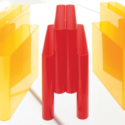 Magazine holder by Kartell Orangy red