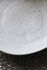 Assiette à mignardises Pion / Ø 16 cm - Porcelaine mouchetée - House Doctor